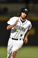 Center fielder Gene Cone (9) of the Columbia Fireflies rounds third base in a game against the Lakewood BlueClaws on Friday, May 5, 2017, at Spirit Communications Park in Columbia, South Carolina. Lakewood won, 12-2. (Tom Priddy/Four Seam Images)