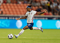 HOUSTON, TX - JUNE 10: Crystal Dunn #19 of the USWNT punts the ball during a game between Portugal and USWNT at BBVA Stadium on June 10, 2021 in Houston, Texas.
