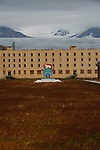 """Pyramiden (Danish, Norwegian and Swedish meaning """"the pyramid"""", Russian: ????????, piramida) is an abandoned Russian settlement and coal mining community on the archipelago of Svalbard, Norway. It was founded by Sweden in 1910 and sold to the Soviet Union in 1927. It lies at the foot of the Billefjorden on the island of Spitsbergen and is named for the pyramid-shaped mountain adjacent to the town.<br /> <br /> The settlement once had a population of over 1,000 inhabitants,[1] but was abandoned on 10 January 1998 by its owner, the state-owned Russian company Arktikugol Trust. It is now a ghost town. Within the buildings, things remain largely as they were when the settlement was abandoned in a hurry.<br /> <br /> There are no restrictions on visiting Pyramiden, but visitors may not enter any buildings without permission, even if the doors are open, due to the health and safety hazards involved. While most buildings are now locked, breaking into the buildings, vandalism and theft have become a serious threat to Pyramiden."""