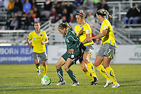 Lindsay Tarpley, marked by Allison Falk #3, and Sara Larsson #7...Saint Louis Athletica defeated Philadelphia Independence 2-1 at Anheuser Busch Soccer Park, Fenton, MO.