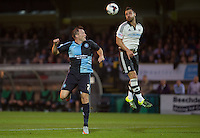 Nikolay Bodurov of Fulham clears the ball from Garry Thompson of Wycombe Wanderers during the Capital One Cup match between Wycombe Wanderers and Fulham at Adams Park, High Wycombe, England on 11 August 2015. Photo by Andy Rowland.