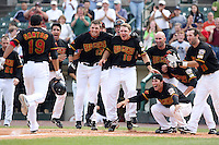 August 11th 2008:  Sergio Santos (19) comes to home plate after hitting a game ending walk off home run in the bottom of the 9th inning.  Waiting at home are Alejandro Machado (38), Brock Peterson (17), Luke Hughes (18), Howie Clark (12), Trevor Plouffe (9), Anthony Swarzak (37) and Jason Pridie (11),  during a game at Frontier Field in Rochester, NY.  Photo by:  Mike Janes/Four Seam Images