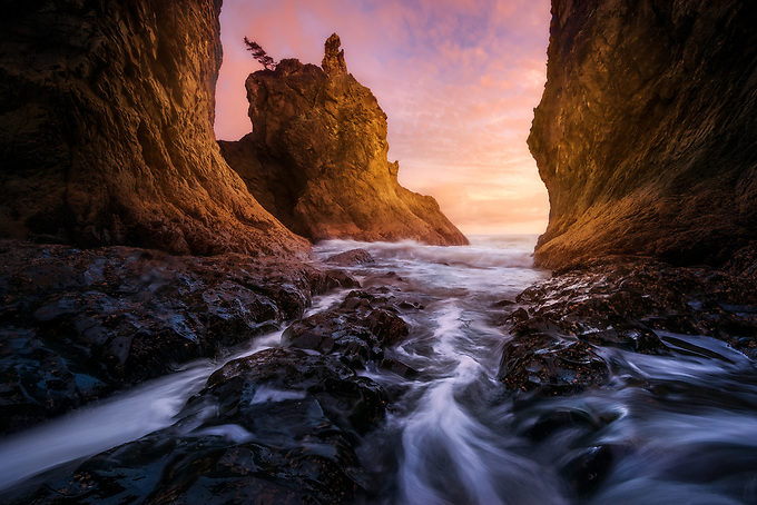The receding water from an incoming tide flows through this sea cave at sunset, providing a unique perspective on the massive sea stacks on the Olympic Coast.<br /> <br /> ARTIST CHOICE: 24x36 Lumachrome/Acylic