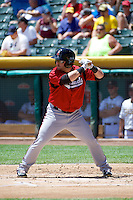 Caleb Gindl (13) of the Nashville Sounds at bat against the Salt Lake Bees in Pacific Coast League action at Smith's Ballpark on June 22, 2014 in Salt Lake City, Utah.  (Stephen Smith/Four Seam Images)