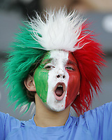 A young Italian fan cheers his team on.  Italy defeated France on penalty kicks after leaving the score tied, 1-1, in regulation time in the FIFA World Cup final match at Olympic Stadium in Berlin, Germany, July 9, 2006.