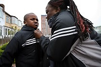 "48 year old Augustine from DR Congo walks the streets of North London with her son Jeneil . She worked as a nurse in a hospital in DR Congo but fled after she was arrested for her involvement in an opposition political party. she has her six year old son Jeneil with her and both are destitute, sleeping in churches, on friends' floors and sometimes outside. Her son has a school place but because she is always sleeping in different places and has no money for bus fares it is sometimes hard to make sure he attends. ""My son and I only eat once a day. My church gives me two to five GBP a week and I use that money to buy fruit for my son."" Augustine is one of an estimated 300,000 rejected asylum seekers living in the UK."