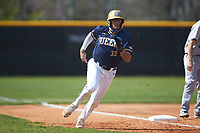 Carter Foster (33) of the Queens Royals rounds third base during game two of a double-header against the Catawba Indians at Tuckaseegee Dream Fields on March 26, 2021 in Kannapolis, North Carolina. (Brian Westerholt/Four Seam Images)