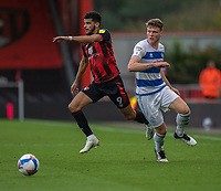 Bournemouth's Junior Stanislas (left) holds off the challenge from Queens Park Rangers' Rob Dickie (right) <br /> <br /> Photographer David Horton/CameraSport<br /> <br /> The EFL Sky Bet Championship - Bournemouth v Queens Park Rangers - Saturday 17th October 2020 - Vitality Stadium - Bournemouth<br /> <br /> World Copyright © 2020 CameraSport. All rights reserved. 43 Linden Ave. Countesthorpe. Leicester. England. LE8 5PG - Tel: +44 (0) 116 277 4147 - admin@camerasport.com - www.camerasport.com