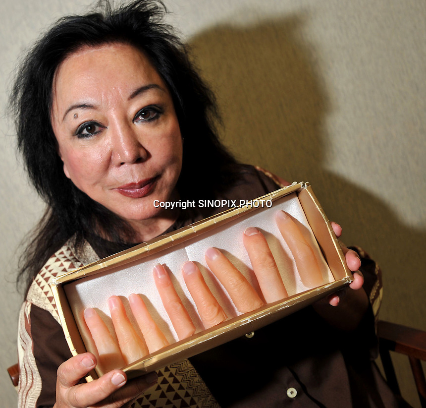 Platic surgeon Maria Niino, holds prosthetic fingers that she makes for Yakuza (Japanese gangsters) who have had to cut their own fingers off as a punishment from their crime bosses in Tokyo Japan, Thursday 4th June.   The fingers are provided to those Yakuza who want to hide their criminal past.<br /><br />Photo by Richard Jones/Sinopix