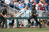 Vanderbilt Commodores third baseman Austin Martin (16) rounds third base headed home during Game 8 of the NCAA College World Series against the Mississippi State Bulldogs on June 19, 2019 at TD Ameritrade Park in Omaha, Nebraska. Vanderbilt defeated Mississippi State 6-3. (Andrew Woolley/Four Seam Images)