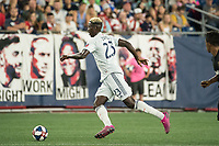 FOXBOROUGH, MA - AUGUST 4: Wilfried Zahibo #23 of New England Revolution advances the ball down the field during a game between Los Angeles FC and New England Revolution at Gillette Stadium on August 3, 2019 in Foxborough, Massachusetts.