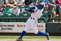 Round Rock Express shortstop Jurickson Profar #10 extends his swing after connectting for a seventh inning grand slam home run to center field against the New Orleans Zephyrs in the Pacific Coast League baseball game on April 21, 2013 at the Dell Diamond in Round Rock, Texas. Round Rock defeated New Orleans 7-1. (Andrew Woolley/Four Seam Images).