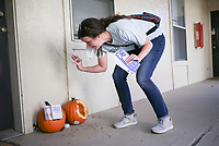 Kelly Krout drops off info cards as she campaigns, Friday, October 16, 2020 at The Links apartment complex in Lowell. Krout is running in the House district 90 race in Rogers/Lowell. Check out nwaonline.com/2010018Daily/ for today's photo gallery. <br /> (NWA Democrat-Gazette/Charlie Kaijo)