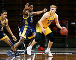 SIOUX FALLS, SD - MARCH 7: Franck Kamgain #11 of the UMKC Kangaroos applies pressure to Sam Griesel #5 of the North Dakota State Bison during the Summit League Basketball Tournament at the Sanford Pentagon in Sioux Falls, SD. (Photo by Richard Carlson/Inertia)