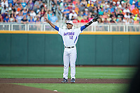 Richie Martin (12) of the Florida Gators looks on during a game between the Miami Hurricanes and Florida Gators at TD Ameritrade Park on June 13, 2015 in Omaha, Nebraska. (Brace Hemmelgarn/Four Seam Images)
