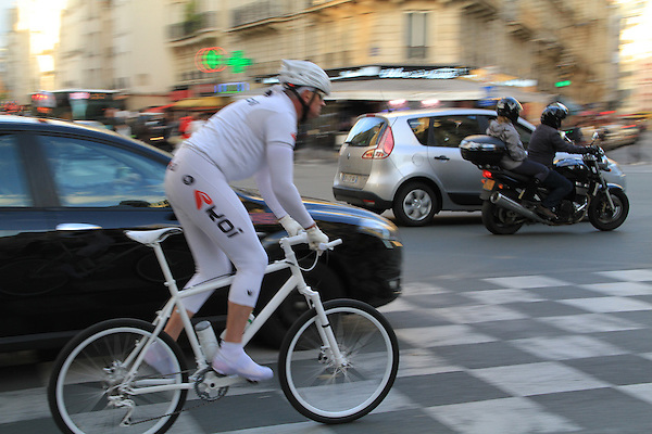 Man riding bike near the Sorbonne and Pantheon, Paris, France. .  John offers private photo tours in Denver, Boulder and throughout Colorado, USA.  Year-round. .  John offers private photo tours in Denver, Boulder and throughout Colorado. Year-round.