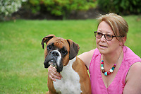 Pictured: Diane McPhee with her dog Boomer, after she was attacked by two dogs in the Tonna area on Neath, south Wales, UK.<br /> Re: Diane McPhee was attacked by two rottweiler dogs which were at the time handled by Ailsa Lisanna Truman, while walking her own dog Boomer in a path in the Tonna area of Neath, south Wales. She was saved by farmer Richard Williams who was working on his property nearby. Subsequently, the case was dropped by a Crown Court judge as the police and the CPS failed to identify the exact dog that bit Mrs McPhee.