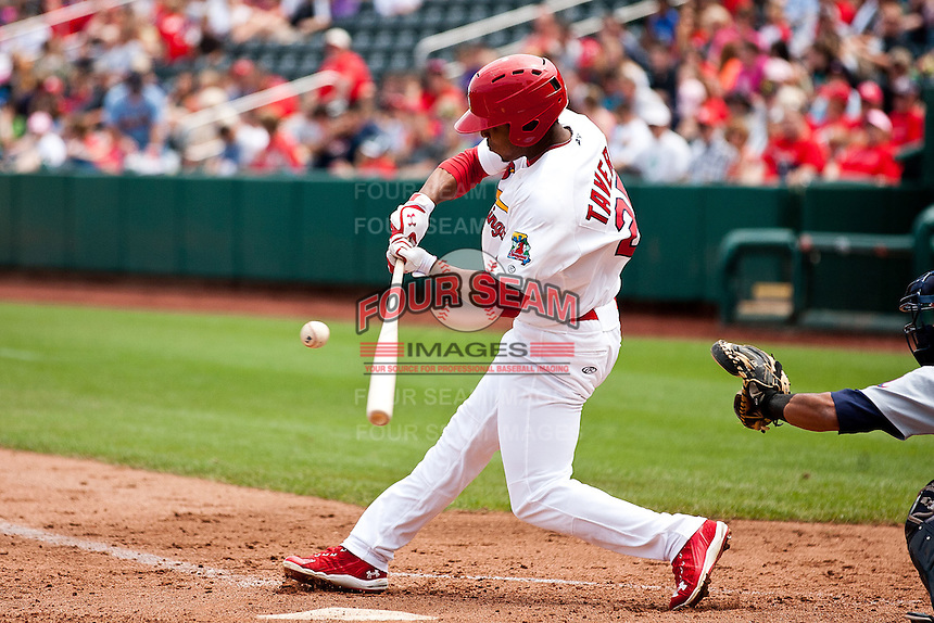 Oscar Taveras (25) of the Springfield Cardinals makes contact on a pitch during a game against the Arkansas Travelers at Hammons Field on May 8, 2012 in Springfield, Missouri. (David Welker/ Four Seam Images)
