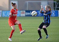 20140606 - Koksijde , BELGIUM : Twente's Larissa Wigger pictured with Brugge's Silke Demeyere (r) during the soccer match between the women teams of Club Brugge Vrouwen  and FC Twente Vrouwen  , on the 30th matchday of the BeNeleague competition on Friday 6th June 2014 in Koksijde .  PHOTO DAVID CATRY