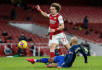 17th December 2020, Emirates Stadium, London, England;  Arsenals David Luis challenged by Southamptons Theo Walcott during the English Premier League match between Arsenal and Southampton