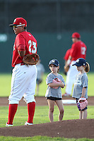 Batavia Muckdogs infielder Romulo Ruiz with two members of the stars of the game before a game against the Jamestown Jammers at Dwyer Stadium on June 27, 2011 in Batavia, New York.  Batavia defeated Jamestown 4-3.  (Mike Janes/Four Seam Images)