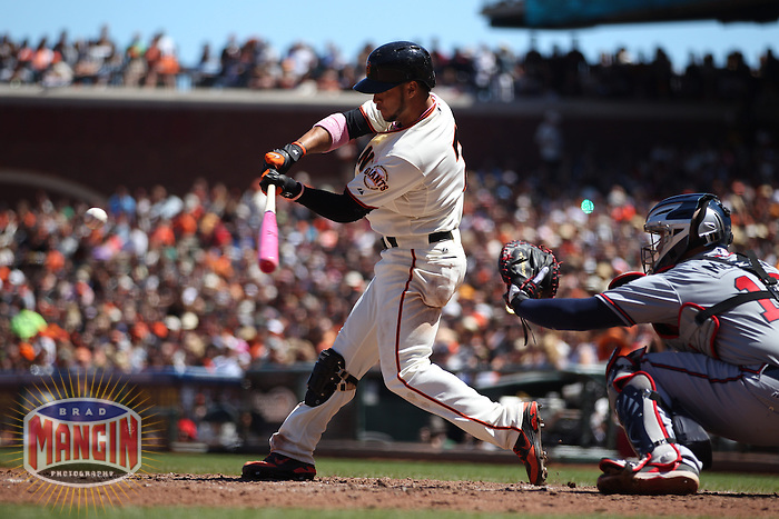 SAN FRANCISCO, CA - MAY 12:  Gregor Blanco #7 of the San Francisco Giants bats with a pink bat in honor of Mother's Day and breast cancer awareness against the Atlanta Braves during the game at AT&T Park on Sunday, May 12, 2013 in San Francisco, California. Photo by Brad Mangin