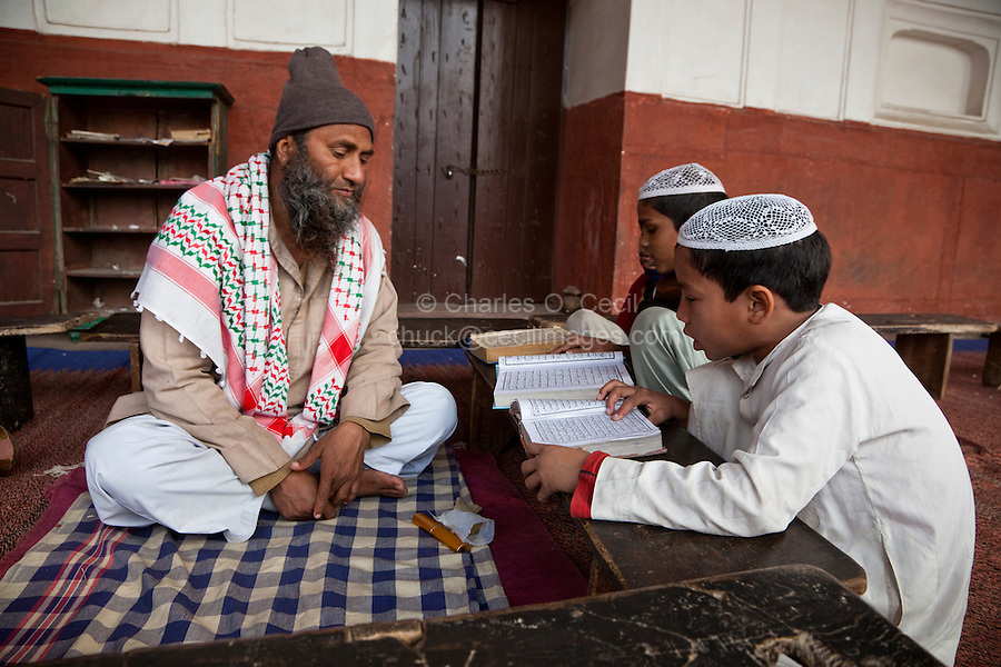 Agra, India.  Students Learning to Read the Koran with their Imam.