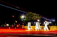 """""""LAX Sign Blur"""" by Art Harman. I had to stand on a narrow island across traffic to get this shot of a plane over-flying an LAX airport sign, and to capture the blur of red taillights."""