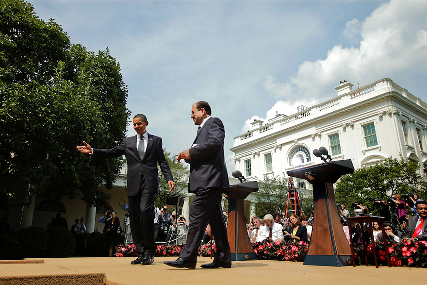 President Barack Obama and Iraqi Prime Minister Nouri al-Maliki depart after a press availability  in the Rose Garden of the White House in Washington...Photo by Brooks Kraft/Corbis..