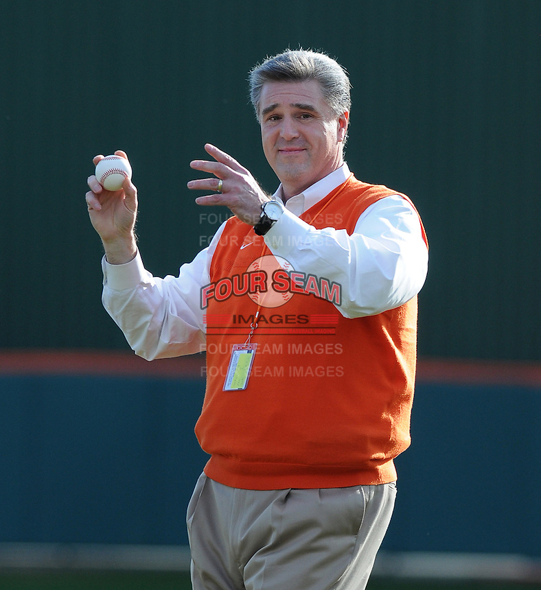 Clemson University athletics director Dan Radakovich throws out the ceremonial first pitch before a game between the Clemson Tigers and William & Mary Tribe on Opening Day, Friday, February 15, 2013, at Doug Kingsmore Stadium in Clemson, South Carolina. Clemson won, 2-0. (Tom Priddy/Four Seam Images)