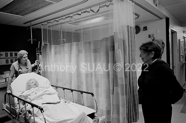 Chicago, Illinois<br /> USA<br /> December 17, 2009<br /> <br /> At the University of Chicago Medical Center Geraldine Martin, 80 years old, is prepared for open heart surgery to have a valve replaced and hole repaired. She is accompanied by her sister Helen Martin  as she heads off to surgery.
