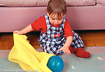 10 month old baby boy Piaget permanence looking for and finding toy ball horizontal