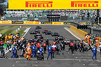 18th July 2021; Silverstone Circuit, Silverstone, Northamptonshire, England; Formula One British Grand Prix, Race Day; The teams leave the grid as the cars start their warm up lap