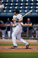 Biloxi Shuckers Michael O'Neill (10) hits a single during a Southern League game against the Montgomery Biscuits on May 8, 2019 at MGM Park in Biloxi, Mississippi.  Biloxi defeated Montgomery 4-2.  (Mike Janes/Four Seam Images)
