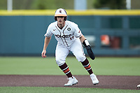 Cade Swisher (11) of the Virginia Tech Hokies takes his lead off of first base against the Georgia Tech Yellow Jackets at English Field on April 17, 2021 in Blacksburg, Virginia. (Brian Westerholt/Four Seam Images)
