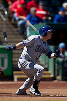 Corey Dickerson (34) of the Tulsa Drillers follows through his swing during a game against the Springfield Cardinals at Hammons Field on September 9, 2012 in Springfield, Missouri. (David Welker/Four Seam Images)