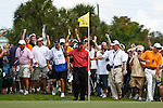 DORAL, FL. - Tiger Woods and the gallery a birdie from the fringe on hole 6 during final round play at the 2009 World Golf Championships CA Championship at Doral Golf Resort and Spa in Doral, FL. on March 15, 2009