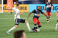 FOXBOROUGH, MA - OCTOBER 19: Andrew Farrell #2 of New England Revolution passes the ball as Kacper Przybylko comes in to tackle during a game between Philadelphia Union and New England Revolution at Gillette on October 19, 2020 in Foxborough, Massachusetts.