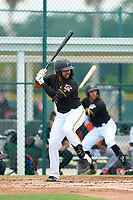 FCL Pirates Black Darwin Baez (19) bats during a game against the FCL Orioles Orange on July 26, 2021 at Pirate City in Bradenton, Florida.  (Mike Janes/Four Seam Images)