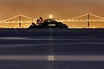 Alcatraz Island light house reflects a ray of light over the calm seas of the San Francisco Bay, California.