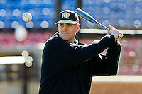 Wake Forest Demon Deacons head coach Tom Walter #32 hits fungos during batting practice at Wake Forest Baseball Park on January 29, 2012 in Winston-Salem, North Carolina.  (Brian Westerholt / Four Seam Images)
