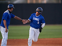 IMG Academy Ascenders James Scott (9) rounds the bases on a home run by Chase Ingram (not shown) during a game against the Montverde Academy Eagles on April 8, 2021 at IMG Academy in Bradenton, Florida.  (Mike Janes/Four Seam Images)