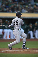 OAKLAND, CA - SEPTEMBER 4:  Andrew McCutchen #26 of the New York Yankees bats against the Oakland Athletics during the game at the Oakland Coliseum on Tuesday, September 4, 2018 in Oakland, California. (Photo by Brad Mangin)