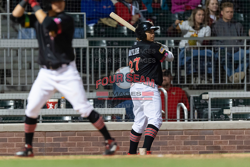 El Paso Chihuahuas right fielder Josh Naylor (27) on deck during a Pacific Coast League game against the Albuquerque Isotopes at Southwest University Park on May 10, 2019 in El Paso, Texas. Albuquerque defeated El Paso 2-1. (Zachary Lucy/Four Seam Images)