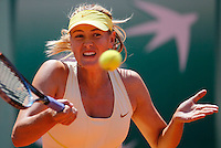 Maria Sharapova of Russia returns against Andrea Petkovic of Germany in the quarter final match of the French Open tennis tournament in Roland Garros stadium in Paris, Wednesday June 1, 2011. Sharapova won in two sets 6-0, 6-3(foto: Srdjan Stevanovic/Starsportphoto ©)
