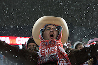 Under a steady snowfall, USA fans watch the USA Men's National Team's World Cup Qualifier against Costa Rica  at Dick's Sporting Good Park in Commerce City, CO on March 22, 2013.