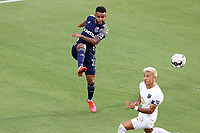 CARY, NC - AUGUST 01: DJ Taylor #27 kicks the ball past Mikey Lopez #5 during a game between Birmingham Legion FC and North Carolina FC at Sahlen's Stadium at WakeMed Soccer Park on August 01, 2020 in Cary, North Carolina.