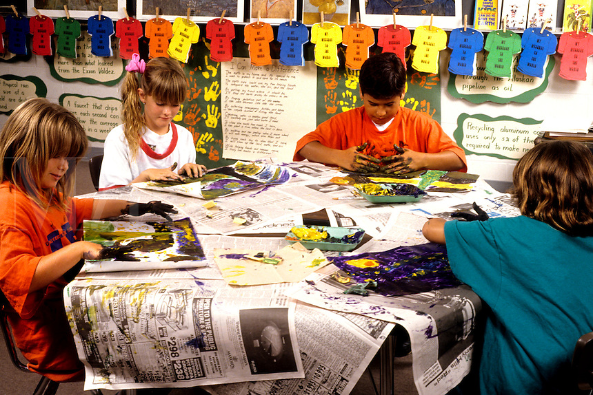 Students in 3rd third grade doing art project in schoo