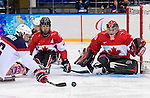 Sochi, RUSSIA - Mar 13 2014 - Adam Dixon and Corbin Watson as Canada takes on USA in Sledge Hockey Semi-Final at the 2014 Paralympic Winter Games in Sochi, Russia.  (Photo: Matthew Murnaghan/Canadian Paralympic Committee)