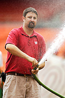 6 September 2006: Grounds Crew Chief hoses down the infield prior to a game at RFK Stadium. ..Mandatory Photo Credit: Ed Wolfstein..